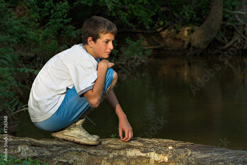 boy on log
