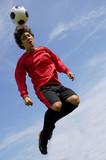 football - soccer player juggling poster