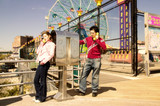 young couple on pay phone poster