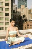 young ethnic girl practising yoga poster