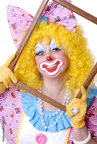 female clown holding a picture frame