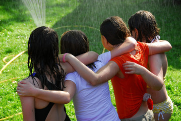 group of girls and sprinkler
