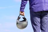 biker holding a helmet poster