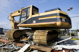 stock photo of heavy equipment on a pile of scrap metal poster