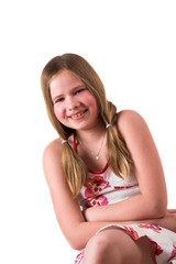 pretty blond ten year old sitting and laughing