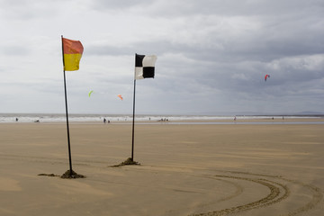 lifeguards flags and kite surfers