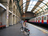 london tube station with foldable bicycle poster