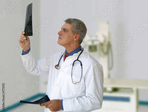 doctor in a hospital holding xrays