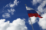 flag of the russia on the sky background poster