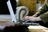 businesswoman typing in hotel atrium poster