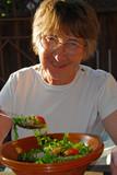 happy eating senior woman poster
