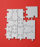 grey jigsaw with the missing piece laying aside poster