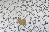silver jigsaw with one missing piece poster