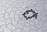 grey jigsaw with space and one of the missing pieces in the cent poster