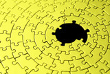 abstract of a yellow jigsaw with missing pieces in the black cen poster