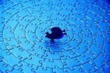 abstract of a blue jigsaw with the last piece upstanding poster