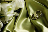 wedding bands on green satin poster