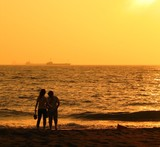 young couple at the beach poster
