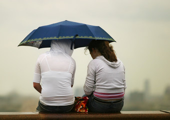 girlfriends under a umbrella