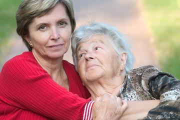 daughter hugging her elderly mother.
