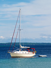 sailboat anchored in harbor