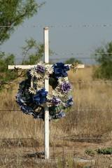 cross on roadside grave