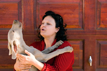 woman and weimaraner dog