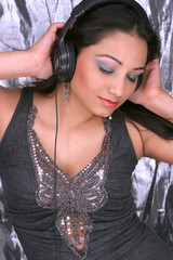 beautiful brunette listening to music