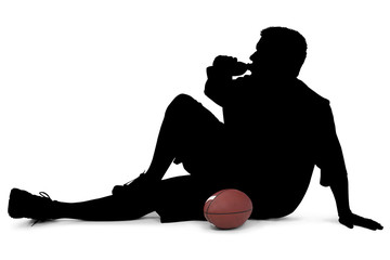 silhouette with clipping path of man with football