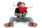 teen boy and toddler boy playing together with ska poster