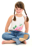 little girl sitting barefoot on white floor poster