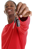 casual young man holding out car key