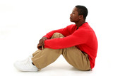casual young man sitting on floor poster