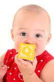 beautiful 10 month old baby girl with toy block poster