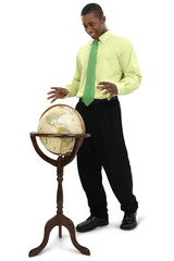attractive businessman reaching for globe