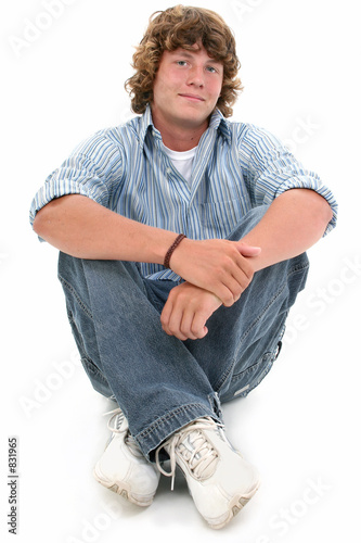 attractive sixteen year old teen boy sitting on fl