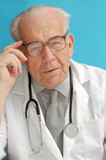 senior family doctor with stethoscope poster