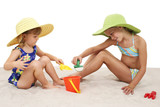 beautiful sisters in beach hats playing in the san poster