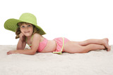 adorable little girl laying in sand poster