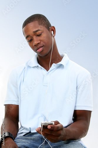 attractive young man listening to headphones poster