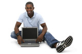 attractive young man sitting on floor with laptop computer poster