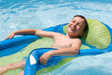 a boy having a fun in a pool poster
