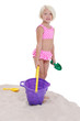 beautiful little girl in pink swim suit with beach toys