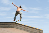 teen boy skateboarding outdoors 3