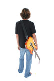 back side of teen boy with electric guitar over wh poster