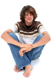 teen boy sitting on white floor poster