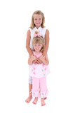 beautiful sisters in pink over white poster