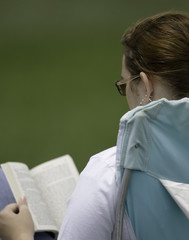 lady reading a book outside
