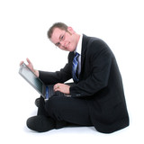 attractive young businessman sitting on floor with poster