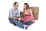 expecting couple sitting near moving boxes poster